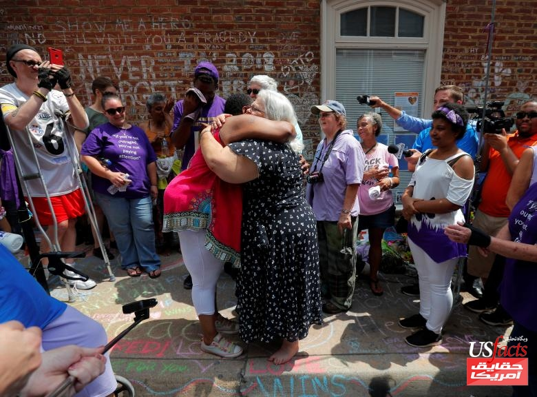 Susan Bro is embraced at the site where her daughter Heather Heyer was killed in Charlottesville