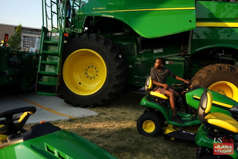 Colby Otundo of Waukee plays with a John Deere tractor at the Iowa State Fair in Des Moines