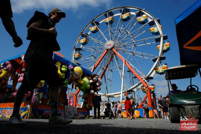 People attend the New Jersey State Fair in Augusta, New Jersey