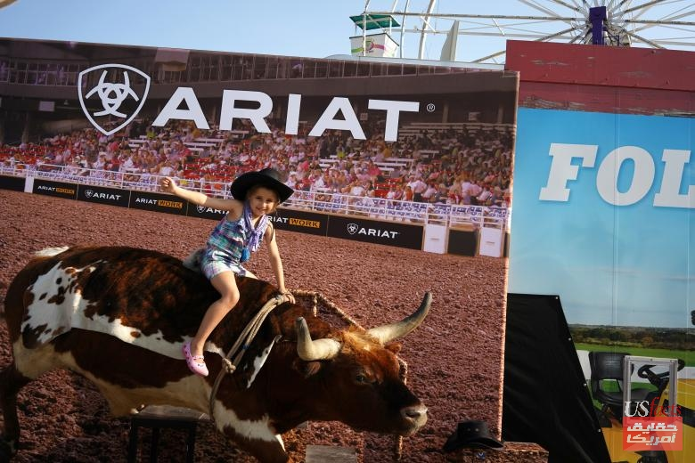 Isabel Heckman poses for a bull riding photo at the Iowa State Fair in Des Moines