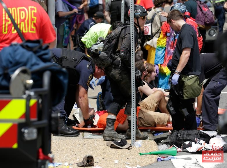 "Rescue workers assist people who were injured when a car drove through a group of counter protestors at the ""Unite the Right"" rally in Charlottesville"
