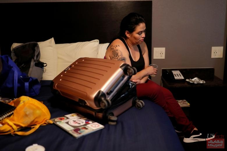 Isabela, an asylum seeker from El Salvador, sits at her hotel room bed as waits for the release of her 17 year-old daughter from a federal contracted shelter in Brownsville, Texas