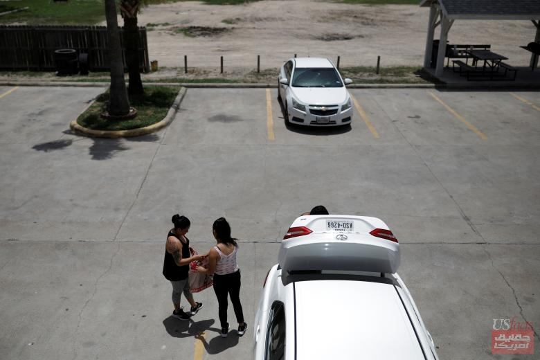Isabela, an asylum seeker from El Salvador, her 17-year-old daughter Dayana and her partner Carlos leave a motel in Brownsville, Texas