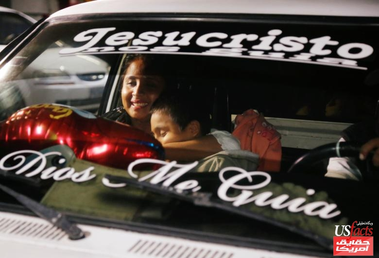 Elsa Ortiz, who had been separated from her son Anthony David Tobar at the U.S. border, holds him inside a car after he was deported from the U.S., in Guatemala City
