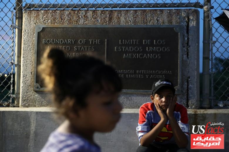 Honduran children seeking asylum wait on the Mexican side of the Brownsville & Matamoros International Bridge after their family was denied entry by U.S. Customs and Border Protection officers near Brownsville