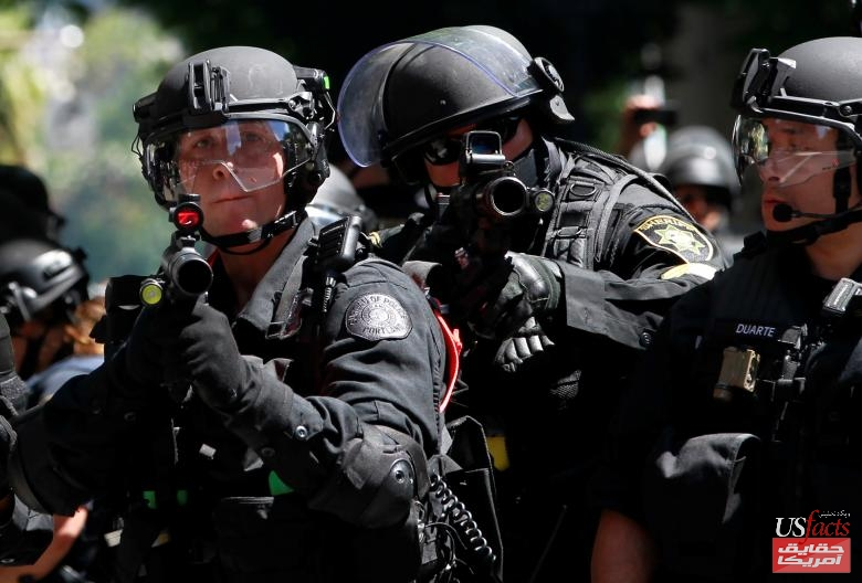 Police fire projectiles at counter-protesters during a rally by the Patriot Prayer group in Portland
