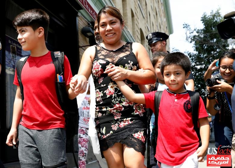 Yeni Gonzalez Garcia, a Guatemalan mother who had been separated from her children, exits the Cayuga Center after being reunited with them in New York