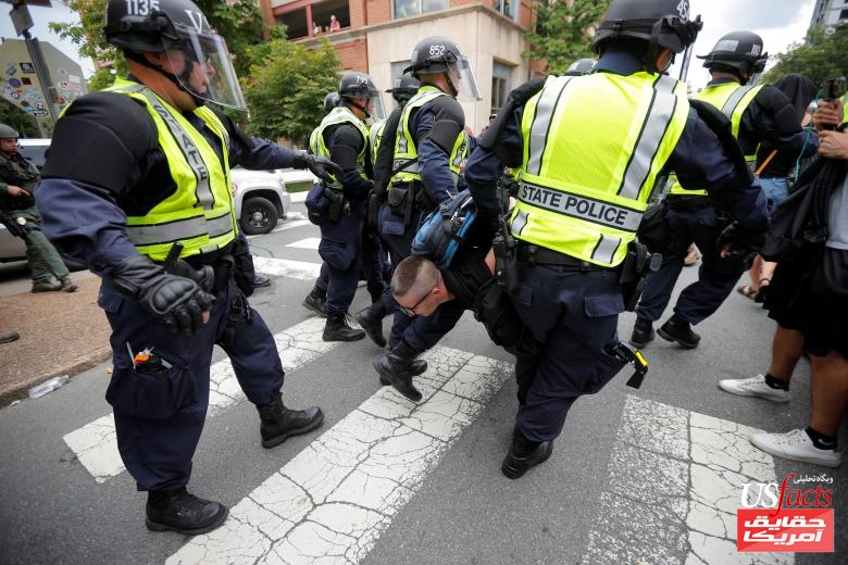 Police carry a protester at the site where Heather Heyer was killedin Charlottesville