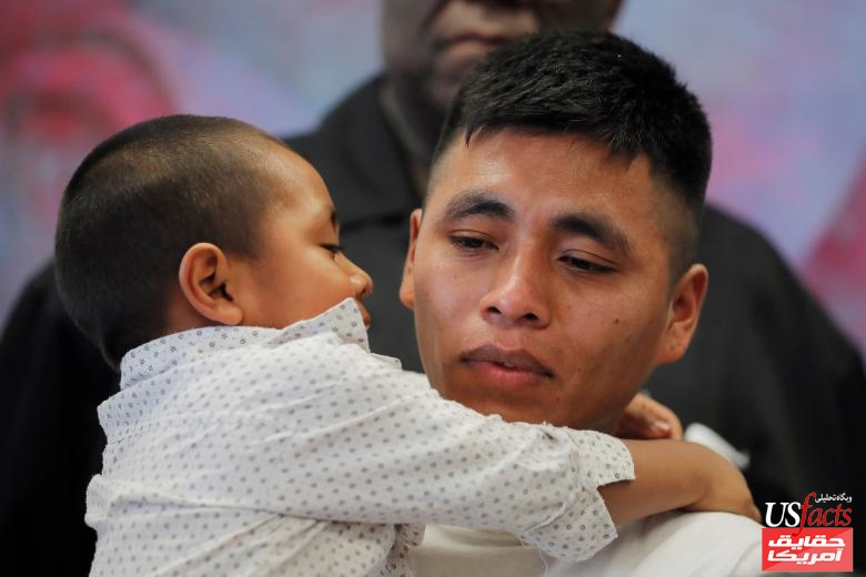Adan, a 26 year old from Guatemala holds his 4 year old son, Juan, during a media availability in New York U.S. after they were reunited after being separated for 58 days following their detention on the Arizona border