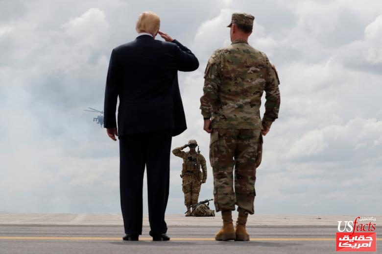 U.S. President Trump salutes U.S. Army soldier as he observes military demonstration with Major General Piatt at Fort Drum, New York