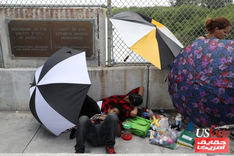 A Honduran family seeking asylum waits on the Mexican side of the Brownsville-Matamoros International Bridge after being denied entry by U.S. Customs and Border Protection officers near Brownsville