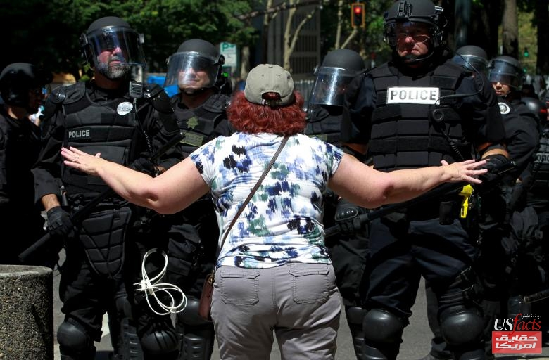 A counter-protester argues with police during a rally by the Patriot Prayer group in Portland