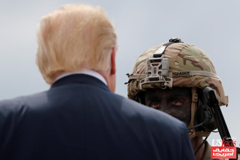U.S. President Trump talks with a U.S. Army soldier as he visits Fort Drum, New York