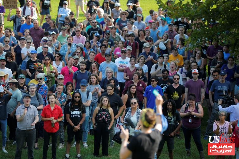 Local activists and community members gather on the one-year anniversary of the death of Heather Heyer during the white-nationalist rally in Charlottesville