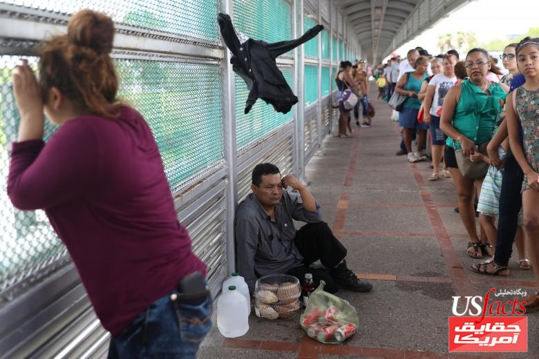 A Guatemalan asylum seeker waits on the Mexican side of the Gateway International Bridge after being denied entry by U.S. Customs and Border Protection officers near Brownsville