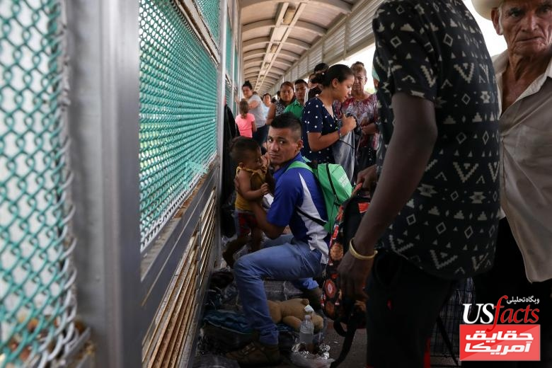 A Honduran father seeking asylum and his 2-year-old son are called by U.S. Customs and Border Protection officers for entry after waiting on the Mexican side of the Brownsville-Matamoros International Bridge near Brownsville