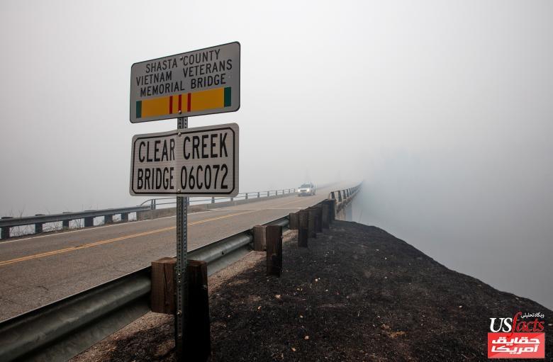 Smoke from the Carr Fire shrouds the Clear Creek Bridge near Igo