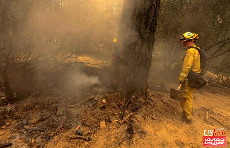 Fire fighters battle the Carr Fire west of Redding