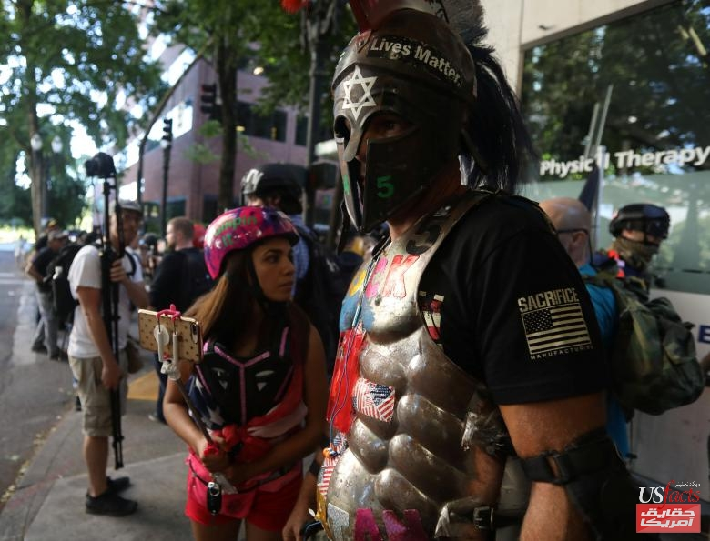 Right-wing supporters of the Patriot Prayer group march together during a rally in Portland