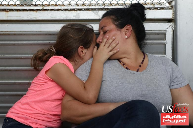 A Cuban mother and daughter seeking asylum wait on the Mexican side of the Brownsville-Matamoros International Bridge after being denied entry by U.S. Customs and Border Protection officers near Brownsville