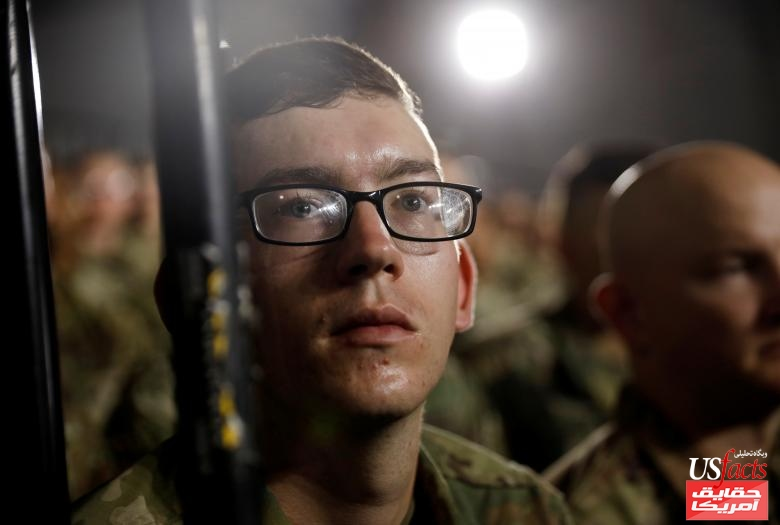 U.S. Army soldier listens as President Trump speaks before signing the National Defense Authorization Act at Fort Drum, New York