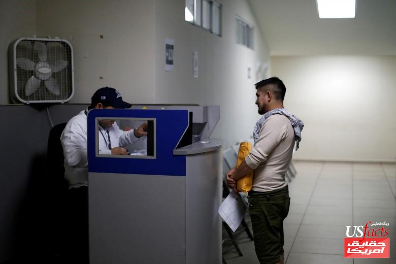 A man deported from the U.S. waits for bus fare at an immigration facility in San Salvador
