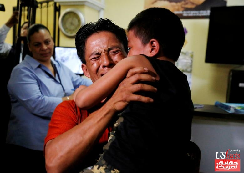 Gilberto Calmo hugs his son Franklin Noe Calmo, who was sent back from detention on Tuesday, after they were separated at the U.S. border, in Guatemala City