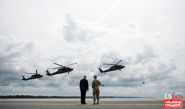U.S. President Trump talks with U.S. Army Major General Piatt during Army demonstration at Fort Drum, New York