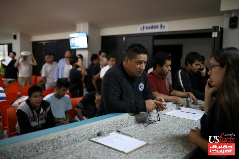 People deported from the U.S. wait to make a phone call to the U.S. at an immigration facility in San Salvador