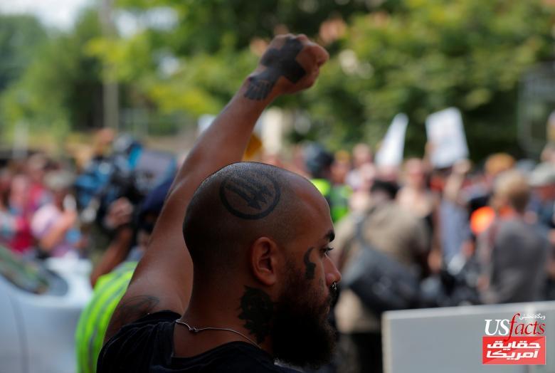 A demonstrator gestures at the site where Heather Heyer was killedin Charlottesville