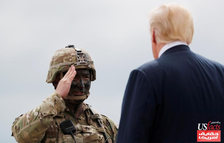 U.S. Army 10th Mountain Division soldier salutes U.S. President Trump during his visit to Fort Drum, New York