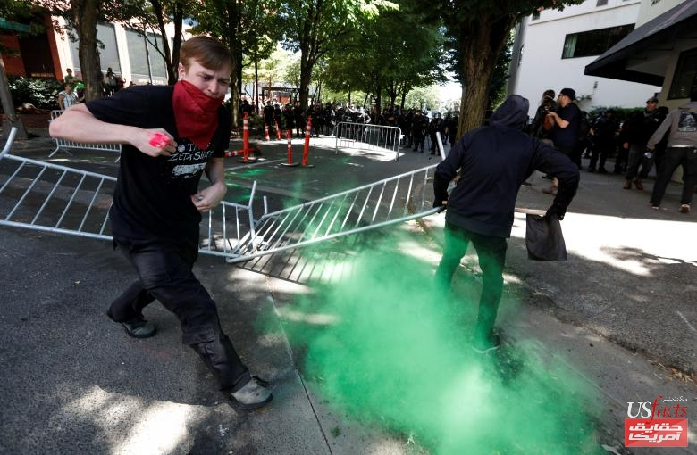 Counter-protesters run from a police projectile during a rally by the Patriot Prayer group in Portland