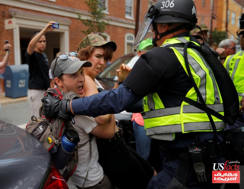 Police detain a protester at the site where Heather Heyer was killed in Charlottesville