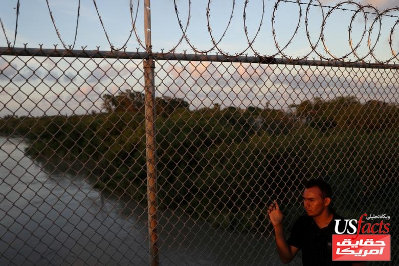 An asylum seeking Honduran man looks out at the Rio Grande while waiting on the Mexican side of the Brownsville & Matamoros International Bridge after being denied entry by U.S. Customs and Border Protection officers near Brownsville