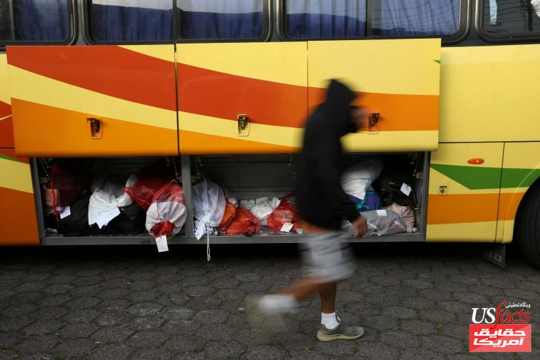 People deported from the U.S. get off a bus at an immigration facility in San Salvador, El Salvador