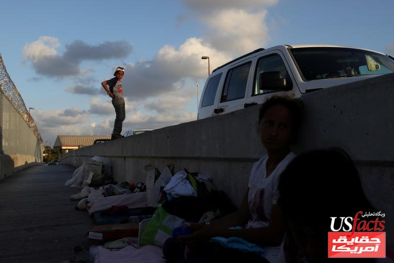 A Honduran family seeking asylum waits on the Mexican side of the Brownsville & Matamoros International Bridge after being denied entry by U.S. Customs and Border Protection officers near Brownsville