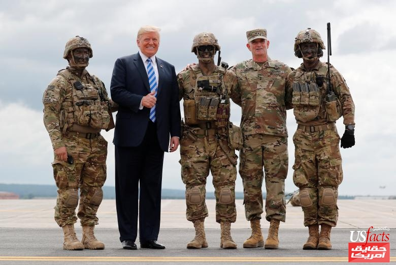 U.S. President Trump gives thumbs up posing with troops during visit to Fort Drum, New York