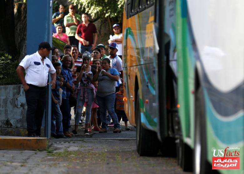 Relatives wait as a bus carrying people deported from the U.S. arrive at an immigration facility in San Salvador, El Salvador