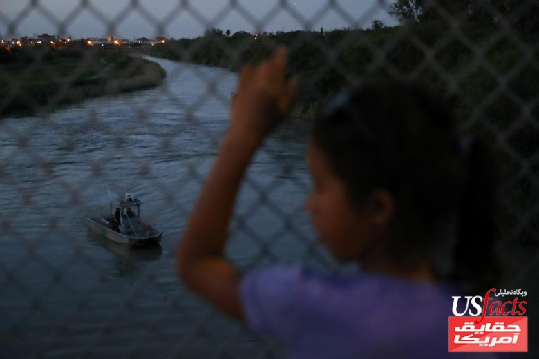 A Honduran girl seeking asylum looks out at the Rio Grande while waiting on the Mexican side of the Brownsville & Matamoros International Bridge after her family was denied entry by U.S. Customs and Border Protection officers near Brownsville