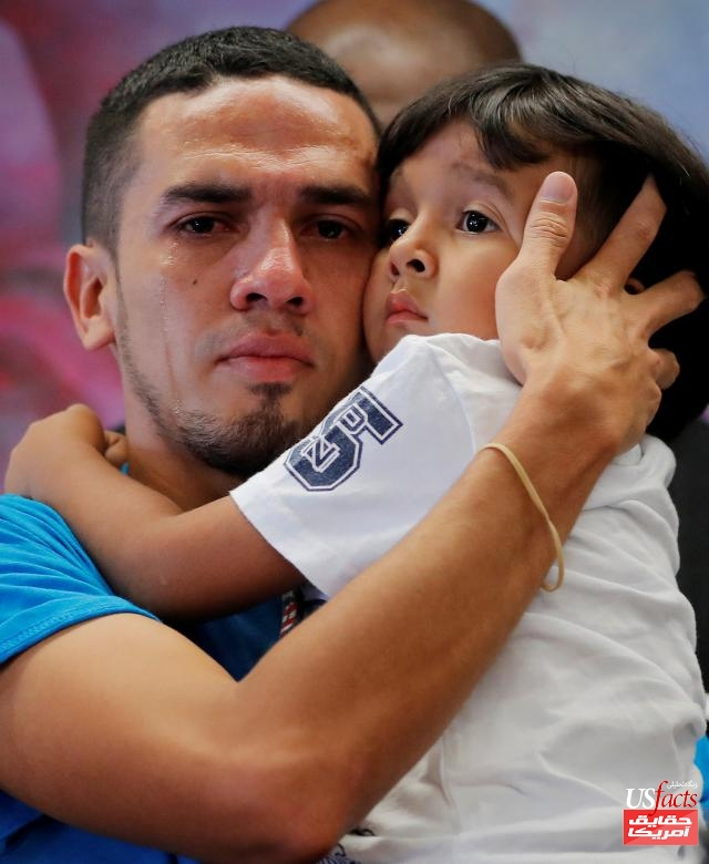 Javier, a 30 year old from Honduras, holds his 4 year old son William during a media availability in New York after they were reunited after being separated for 55 days following their detention at the Texas border