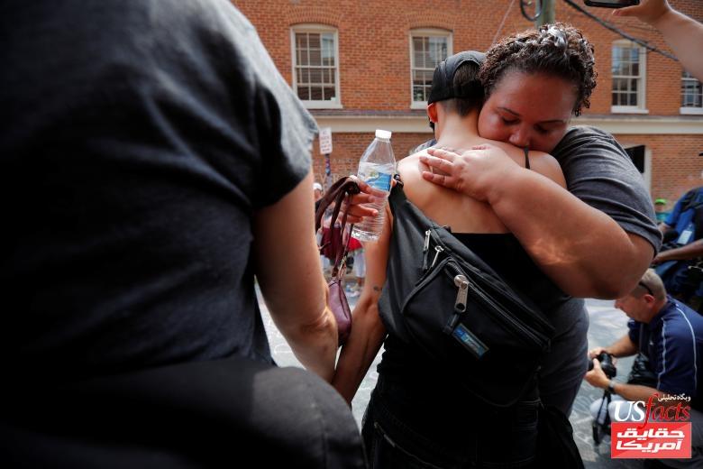 Demonstrators embrace at the site where Heather Heyer was killedin Charlottesville