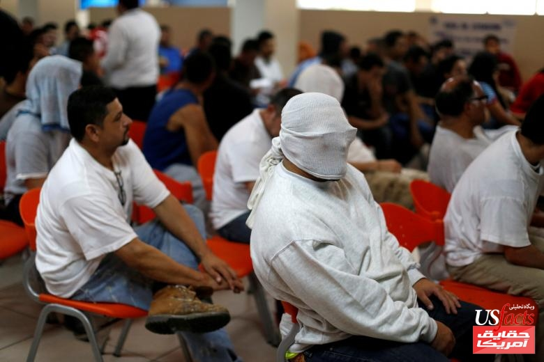 People deported from the U.S. wait to be processed at an immigration facility in San Salvador, El Salvador