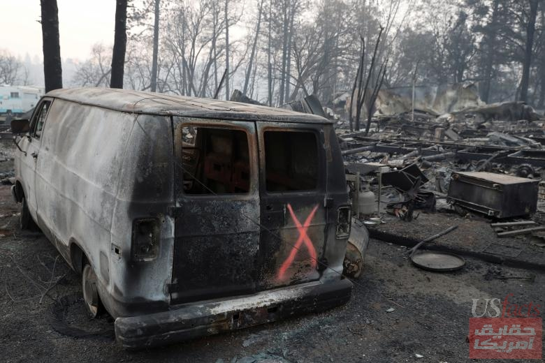 A van marked by search crews is seen in the aftermath of the Camp Fire in Paradise