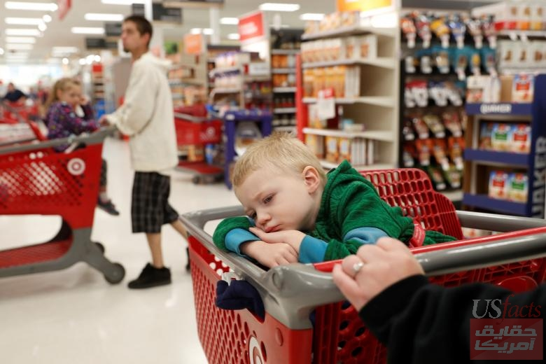 After their home in Paradise was destroyed by the Camp Fire, Landyn Butts, 3, and his family shop for new household items in Chico