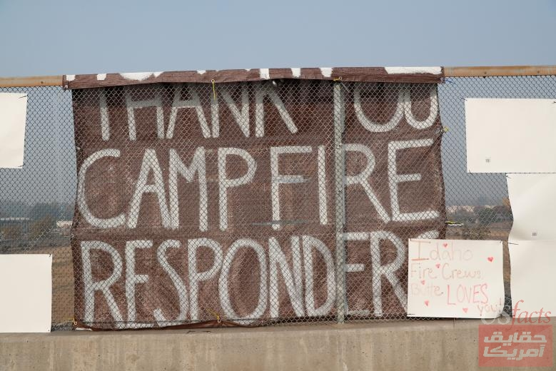 A sign thanking Camp Fire first responders hangs on a highway overpass in Chico