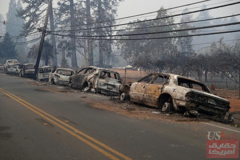 A row of burned vehicles are seen on Skyway during the Camp Fire in Paradise