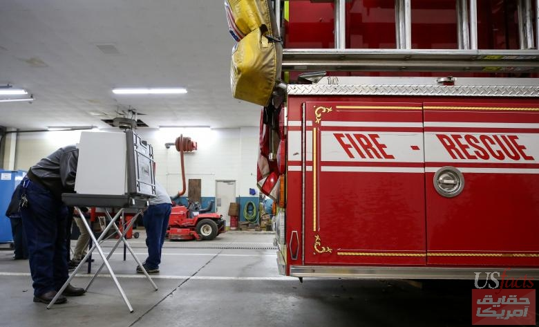People vote in a firehouse for midterm elections in Meriden, Connecticut
