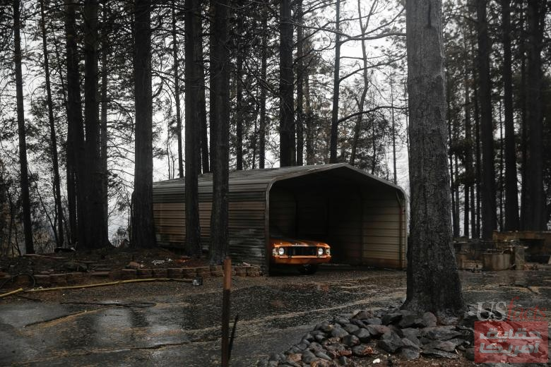 An old car is seen in a shed surrounded by damage caused by the Camp Fire in Paradise