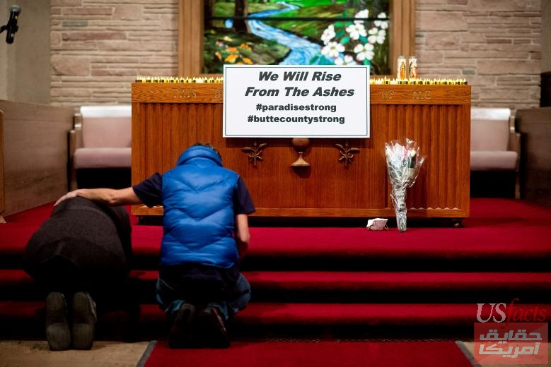 Mourners pray during a vigil for the lives and community lost to the Camp Fire at the First Christian Church of Chico