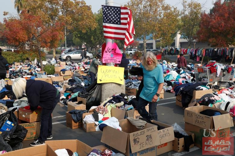 People visit a free clothing donation site for victims of the Camp Fire in Chico